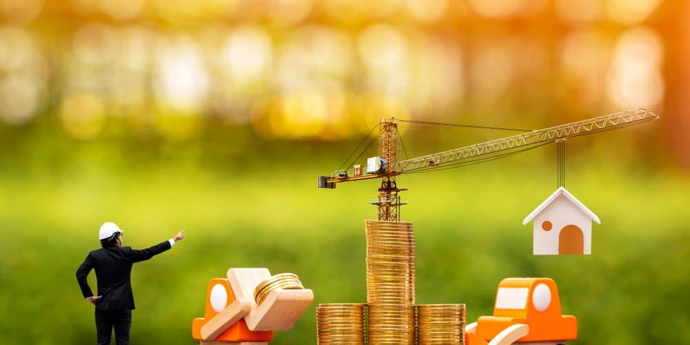 Ein Symbolbild für Baugeld mit Krank und Münzen